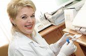 Woman Scientist Using Medical Equipment