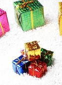 The small gift box group on snow for decoration christmas