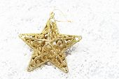 The gold star on snow for decoration christmas