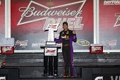 Daytona Beach, FL - Feb 20, 2014:  Denny Hamlin (11) wins the Budweiser Duel at Daytona International Speedway in Daytona Beach, FL.