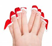 Fingers Faces In Santa Hats Isolated Against White. Happy Friends Christmas Celebrating Concept