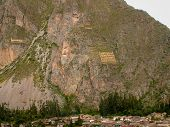 picture of guardian  - The face and shoulders of an ekeko a guardian holding up the mountain Ollantaytambo Peru - JPG