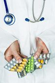 a young doctor prescribes medication. prescription pills are prescribed by a doctor.