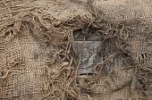background of burlap with a hole for writing text. texture of the wood