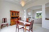 Bright Dining Room With Carved Wood Cabinet
