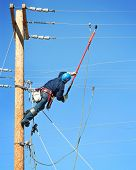 foto of lineman  - an electrical lineman student working on a pole at a lineman college - JPG