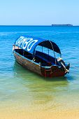 Motor Tourist Boat Lying Near The Beach
