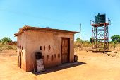 House With Water Tank In A Village In Africa