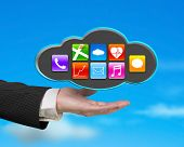 Businessman Showing Black Cloud With App Icons And Sky Background
