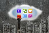 Climbing Businessman Getting App Icons From Cloud With Doodles Wall