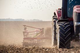 picture of potato-field  - The tractor harvester working on the field - JPG