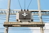 pic of voltage  - Electric transformer on the pole Transform Electric high voltage to low voltage - JPG