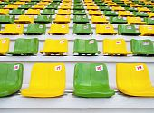 A yellow and green seat on soccer stadium
