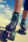 image of skate  - closeup of the feet of a young caucasian man roller skating with quad skates - JPG