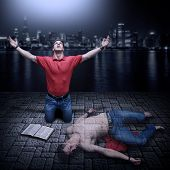 foto of god  - Young man raised in prayer with a Bible beside him - JPG