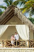 pic of married  - young loving couple on tropical sea background  - JPG