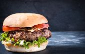 stock photo of beef-burger  - Tasty beef burger with cheese and grilled onionselective focus and blank space - JPG