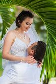 picture of married  - young loving couple on tropical sea background  - JPG
