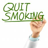 picture of quit  - doctor writing quit smoking words in the air - JPG
