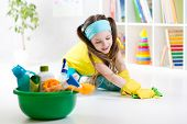 stock photo of cleanse  - Cute child little girl cleanses a floor in nursery at home - JPG