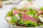 picture of baguette  - Arugula salad with smoked rump sundried tomatoes cashew nuts and mozzarella wholemeal baguette - JPG