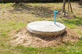 picture of cylinder  - underground cement cylinder of lavatory cesspit in lawn yard - JPG
