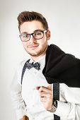 picture of braces  - a handsome young man or hipster with braces and a bow tie isolated over a white background - JPG
