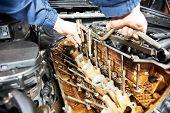 pic of car repair shop  - mechanic repairman at automobile car engine maintenance repair work - JPG