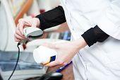 pic of barcode  - pharmaceutical female worker scanning barcode of medicine drug in a pharmacy drugstore  - JPG