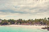 foto of caribbean  - Relaxing on remote Tropical Paradise beach in Dominican Republic or Seychelles - JPG