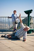 foto of gibraltar  - Happy hilarious senior man tourist on the top of Gibraltar Rock - JPG