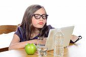 pic of homework  - a little girl doing her homework on her computer on white  - JPG