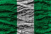 picture of nigeria  - Nigeria national flag painted on wooden bark of tree - JPG