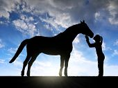 foto of horse girl  - Silhouette of a girl giving a kiss horse in sunset - JPG