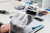 stock photo of stolen  - Technician replacing the screen of a used smartphone - JPG