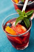 stock photo of sangria  - Refreshing sangria (punch) with fruits picnic idea