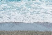 image of tide  - The tide coming in on a beach with wet sand. ** Note: Shallow depth of field - JPG