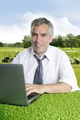 Senior Businessman Golf Course Computer Green Grass