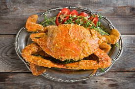 stock photo of cooked crab  - Above view cooked delicious hot and spicy sauce blue crab - JPG