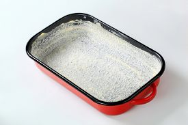 picture of grease  - greased baking tin covered with desiccated coconut - JPG