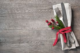 stock photo of christmas  - Christmas table place setting with christmas pine branches - JPG