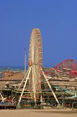 Amusement Park with Ferris wheel with roller coaster