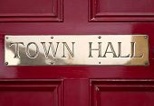 Brass Town Hall Sign On A Door. poster