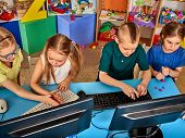 Children computer class us for education and video game. Boys and girls in childrens club who spend poster