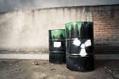 stock photo of hazard  - toxic drum barrel spilled it hazardous content - JPG