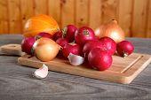 Onions Garlic  Garden Radish On A Table