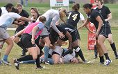Player Being Tackled In A Women's College Rugby Match