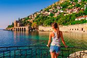 Young Woman Look On Ancient Shipyard From Kizil Kule Tower In Alanya Peninsula, Antalya District, Tu poster