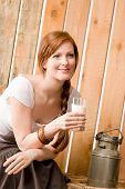 Young Woman Drink Natural Milk In Barn