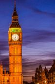 Big Ben Clock Tower at night - London travel. Parliament house at city of Westminster, London, Engla poster